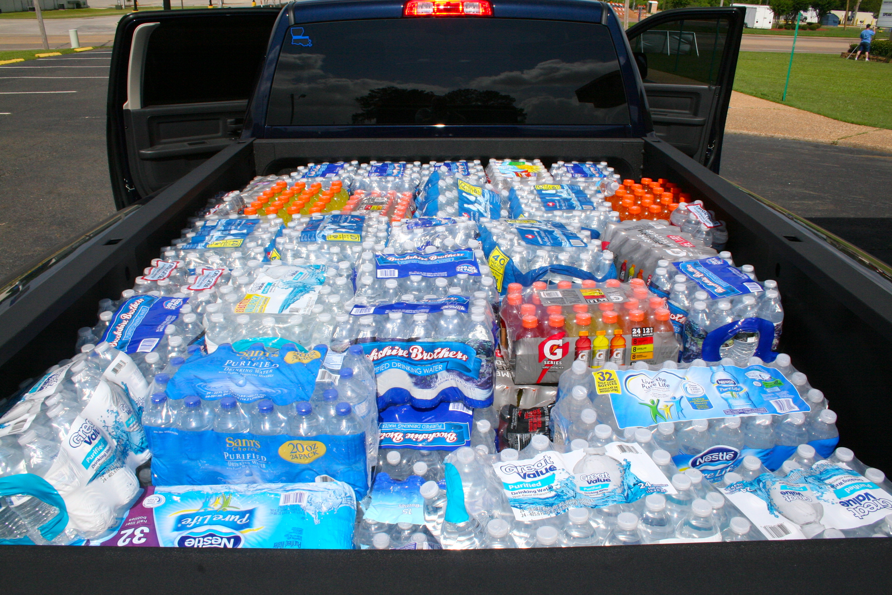 Water and gatorade in the back of truck